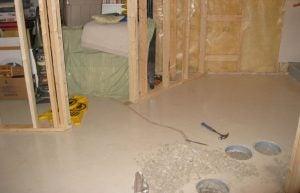 sump pump installation calgary - basement concrete floor ready for install