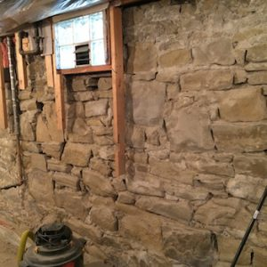 historic foundation restoration calgary - historical stone wall repaired
