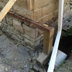 calgary historical foundation repair - historic stone wall being repaired