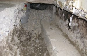 interior drain tile installation calgary - before picture of drain