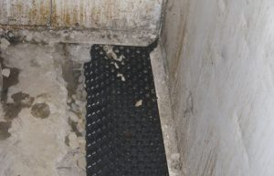 calgary interior tile installation - after picture of drain